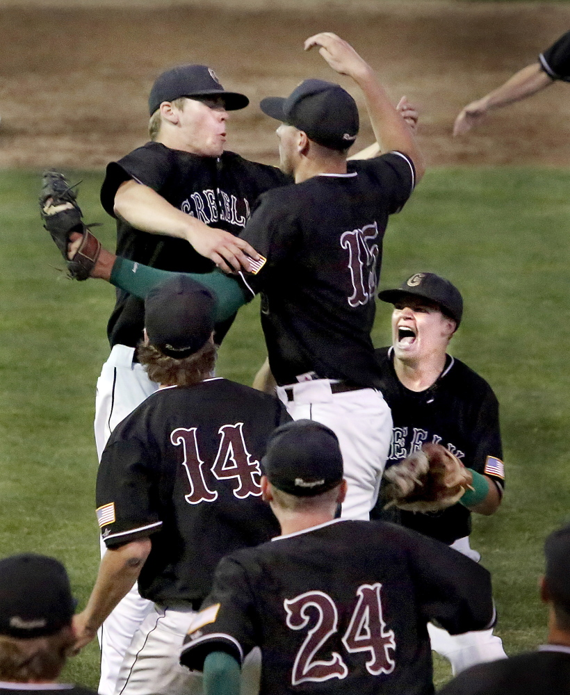 Greely players celebrate after their 4-0 win Wednesday over Lincoln Academy in the Western Class B baseball championship game at St. Joseph's College.