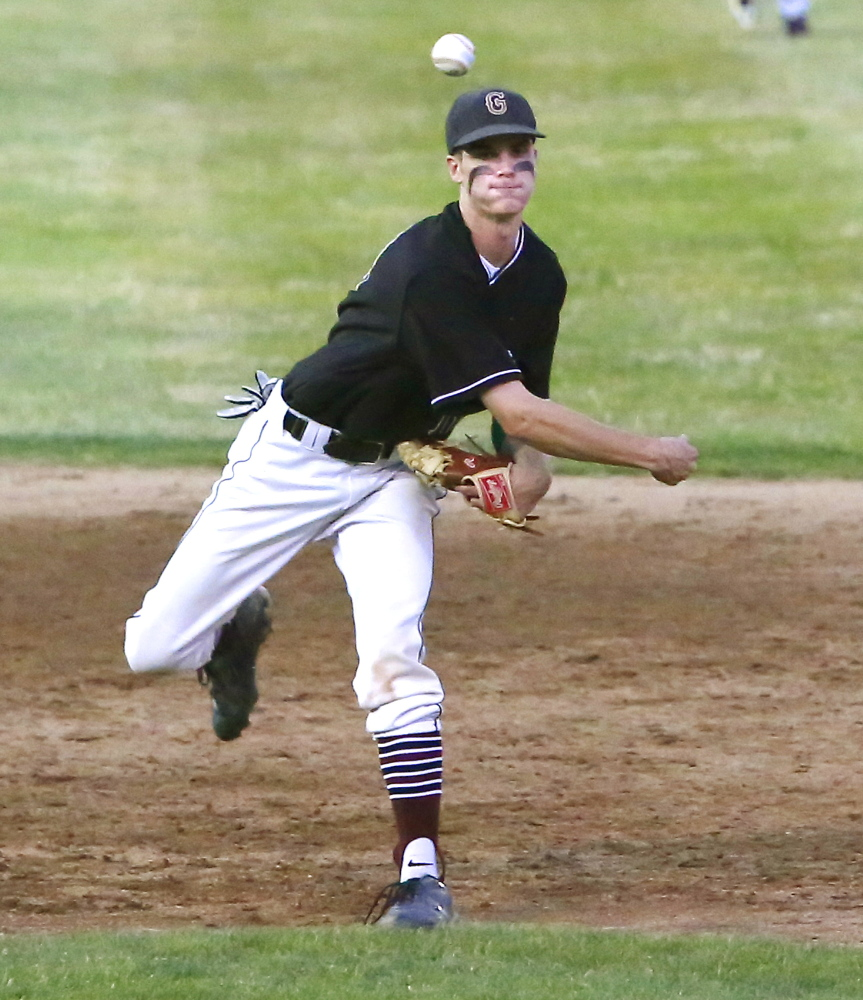 Greely shortstop Patrick O'Shea guns the ball to first base after fielding a grounder during the Western Class B final at St. Joseph's College in Standish. The Rangers will take a 16-3 record into the state final against Caribou, which is 14-6.