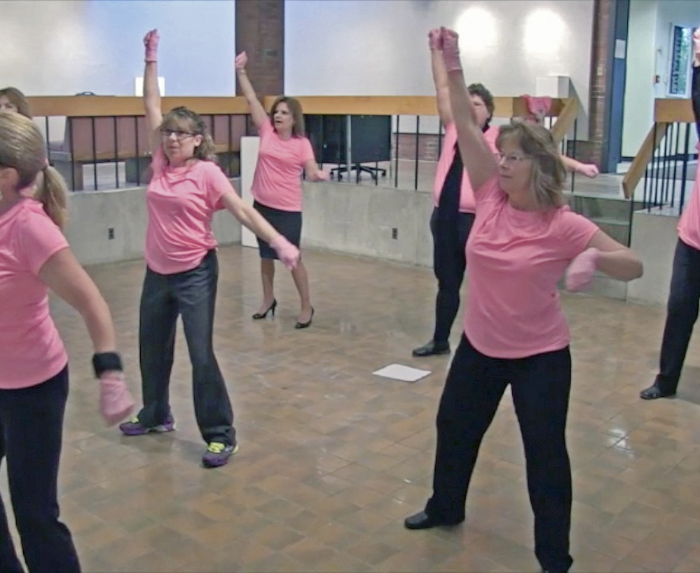 Dancers rehearse at the University of Maine at Augusta for a Pink Glove Dance routine that will be part of a cancer fundraiser video contest.