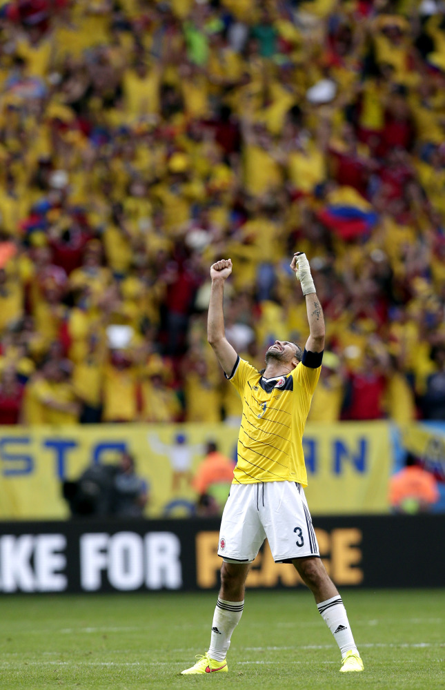 Colombia's Mario Yepes celebrates after the group C World Cup soccer match between Colombia and Ivory Coast at the Estadio Nacional in Brasilia, Brazil, Thursday, June 19, 2014. Colombia won the match 2-1.