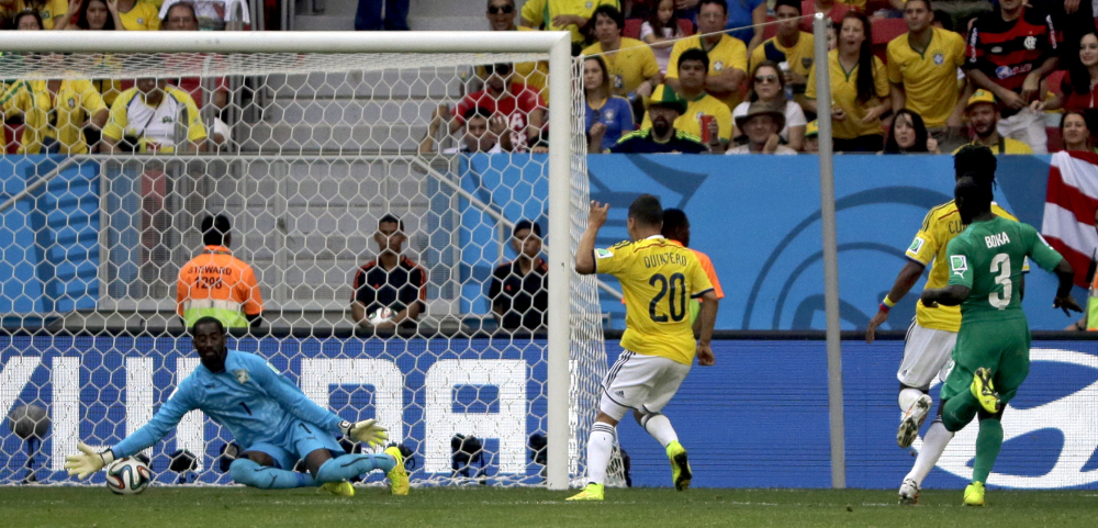 Colombia's Juan Quintero (20) scores his side's second goal during the group C World Cup soccer match.