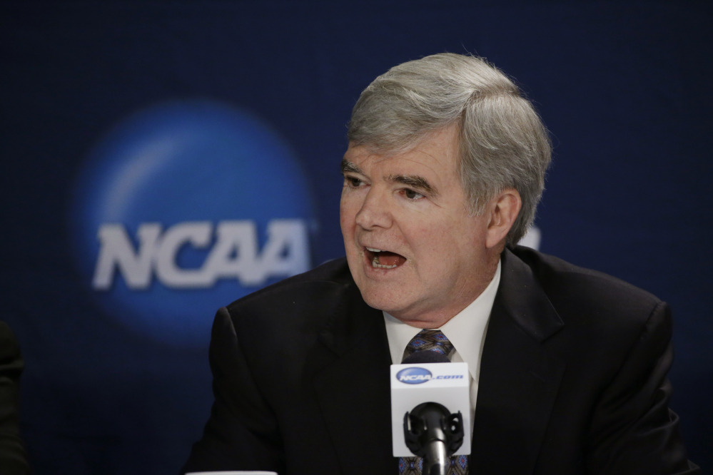 In this April 6, 2014 file photo, NCAA President Mark Emmert answers a question at a news conference in Arlington, Texas. Testifying in a landmark antitrust lawsuit filed against his organization, Emmert said Thursday, June 19, 2014, he believes there is a clear difference between the proposal to pay athletes a few thousand more dollars a year and giving them the equivalent of a salary.
