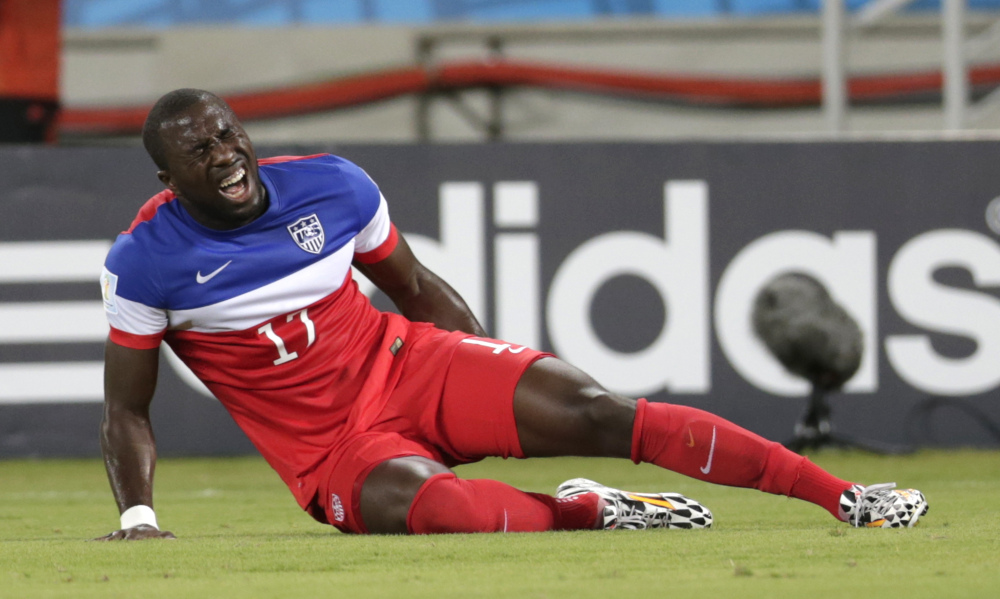 United States' Jozy Altidore grimaces after pulling up injured during the group G World Cup soccer match between Ghana and the United States in Natal, Brazil, Monday, June 16, 2014.