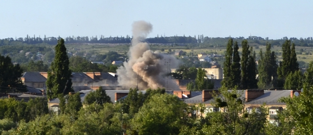 Smoke rises from an explosion near a children's hospital following shelling from Ukrainian government forces in Slovyansk, Ukraine, on Thursday.