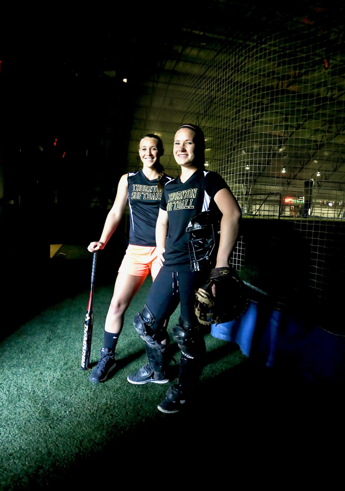 Brooke Cross, left, a junior shortstop, and her sister, senior catcher Aleisha Cross, have found the perfect way to end their time as Thornton Academy teammates – playing for a state softball title.