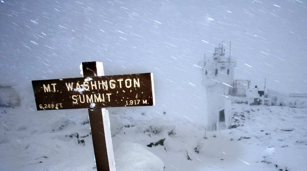 In this Feb. 1, 2007 file photo, wind and driving snow are seen on the top of the highest peak in the Northeast,  Mount Washington, in New Hampshire. Extreme Mount Washington sits on the top of the Northeast's highest peak, in New Hampshire. The museum recently underwent a $1 million transformation from a modest collection of artifacts behind glass to a modern facility packed with hands-on exhibits.