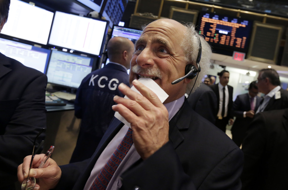 Trader Peter Tuchman works on the floor of the New York Stock Exchange on Friday.
