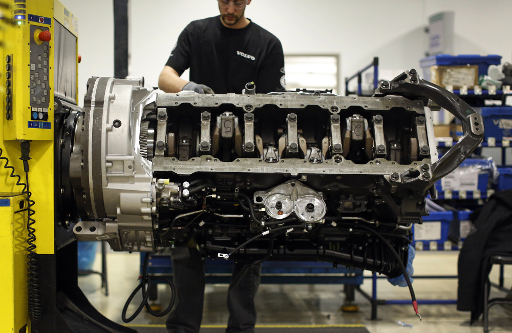 Jon Wyand works on a truck engine assembly line at Volvo Trucks' powertrain manufacturing facility in Hagerstown, Md. Recent good news on manufacturing and hiring has boosted confidence in the economy. Manufacturing is expanding at a healthy pace and the service industry continues to grow.