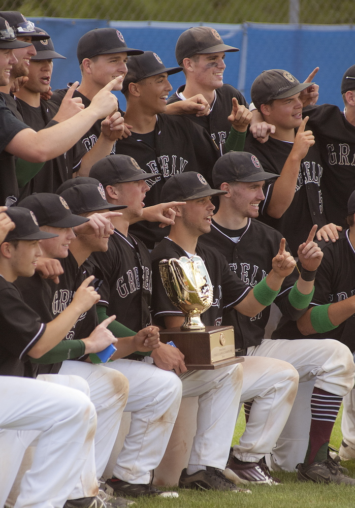 Greely's baseball team poses with championship trophy after defeating Caribou 1-0.