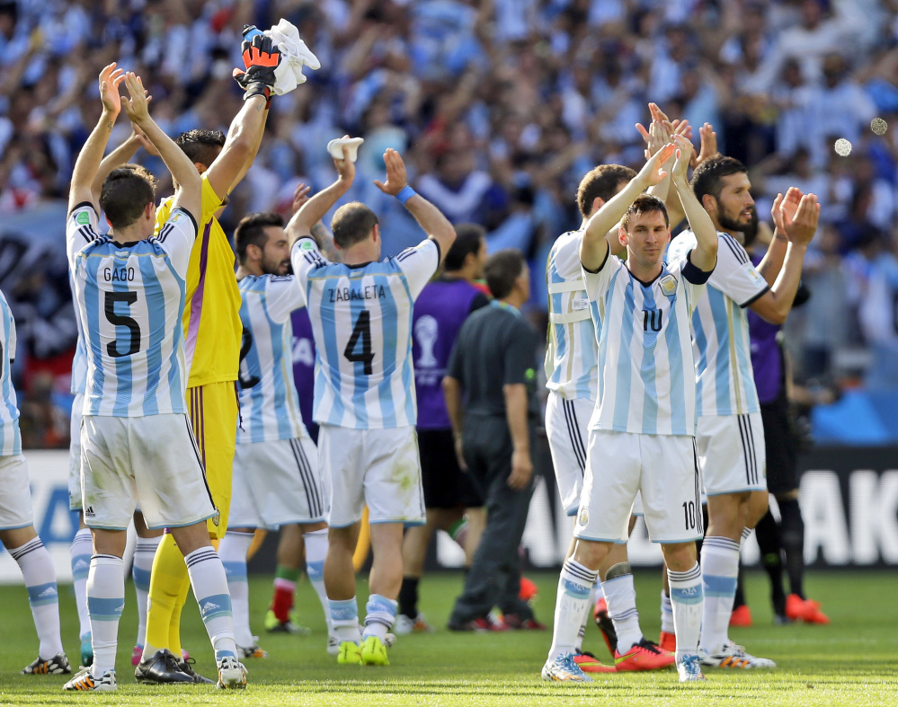 Argentina's Lionel Messi and his teammates applaud after their 1-0 victory over Iran during the group F World Cup soccer match between Argentina and Iran at the Mineirao Stadium in Belo Horizonte, Brazil, on Saturday.