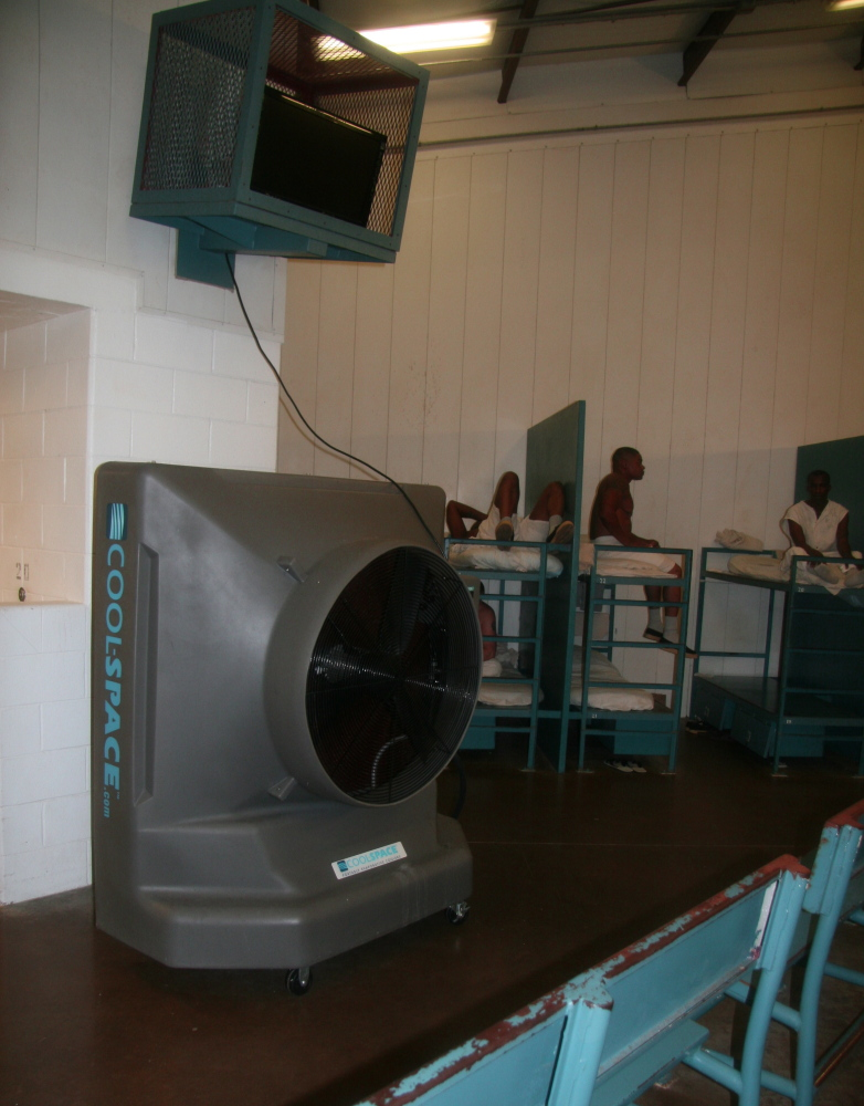 A cooling fan somewhat similar to what's used on the sidelines of early-season football games now mitigates the heat at a jail near Huntsville, Texas.
