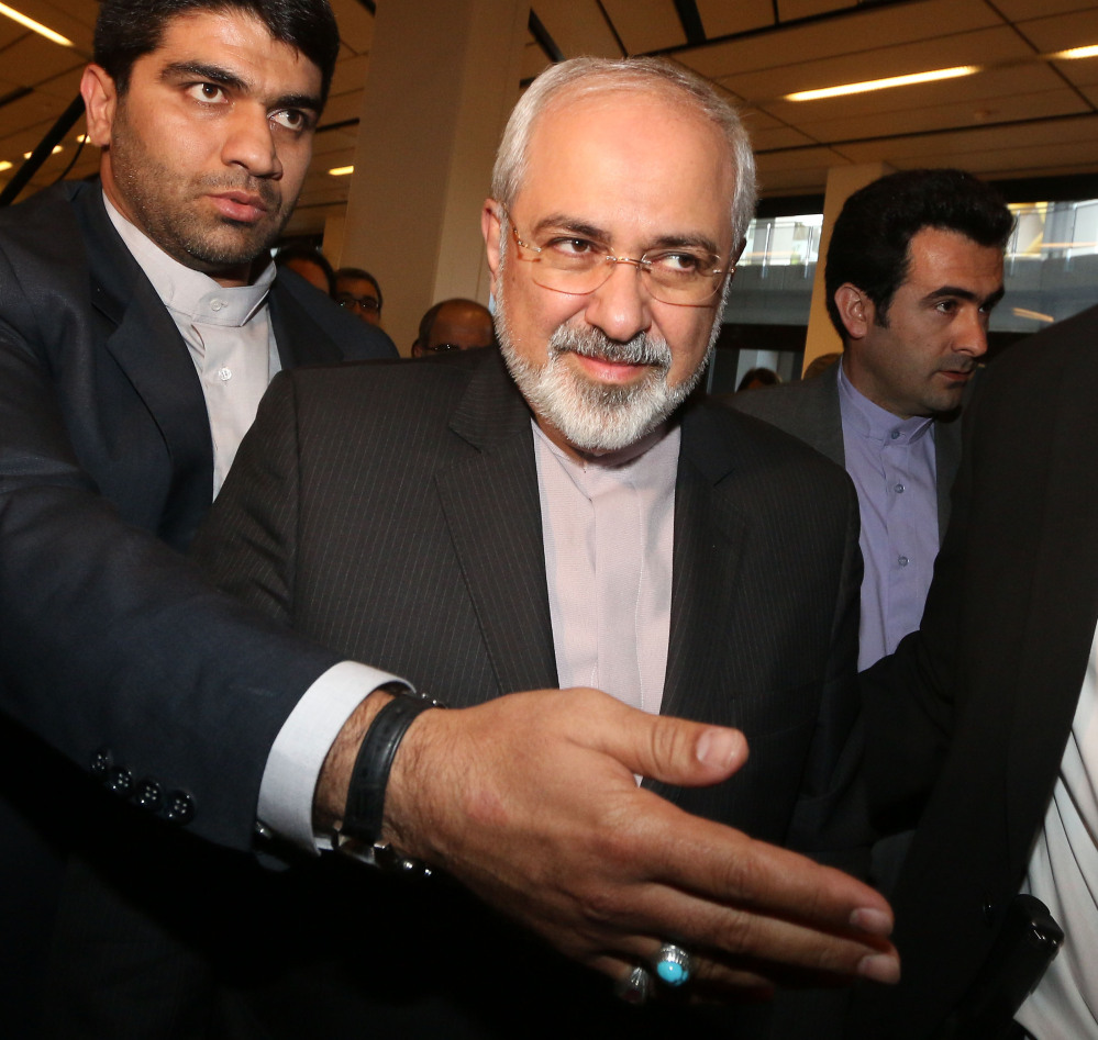 Iranian Foreign Minister Mohammad Javad Zarif, center, exits closed-door nuclear talks in Vienna. After a breakthrough interim agreement last year, the U.S., Iran and other nations are hoping to wrap up a deal this summer that would curb Iran's nuclear program.