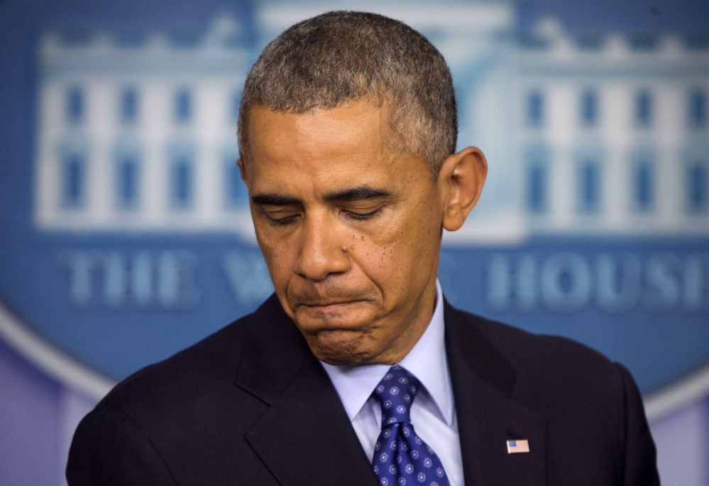 President Barack Obama pausing as he talks about the situation in Iraq at the White House in Washington.