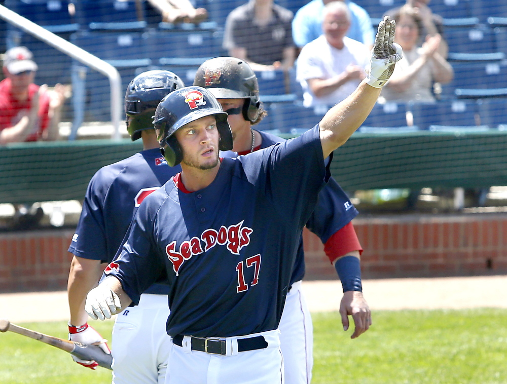 The Sea Dogs' Jonathan Roof celebrates after hitting a two-run homer in the second that put Portland up 3-0.