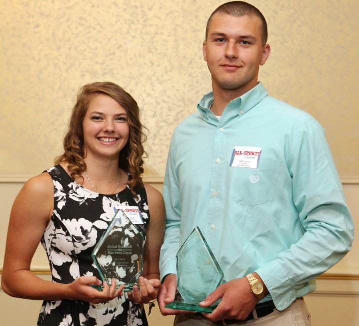 Kate Hall of Lake Region High School and Ben Lucas of Cony High School pose with their awards at the 27th annual All-Sports Awards ceremony Sunday.