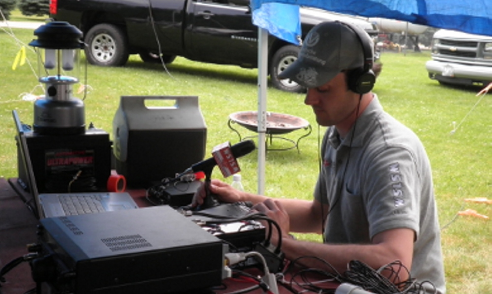 Tim Watson, a member of the Wireless Society of Southern Maine amateur radio club, mans the communication center during the 2013 Field Day event at Wassamki Springs Campground in Scarborough. This year's event will begin at 2 p.m. Saturday at the same locale.