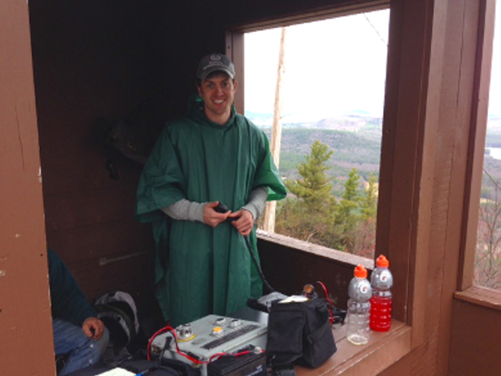 Ham Radio operator Tim Watson sets up a communication station during a summit event, where team members attempt to set distance records for making radio contacts. Photo courtesy Tim Watson.