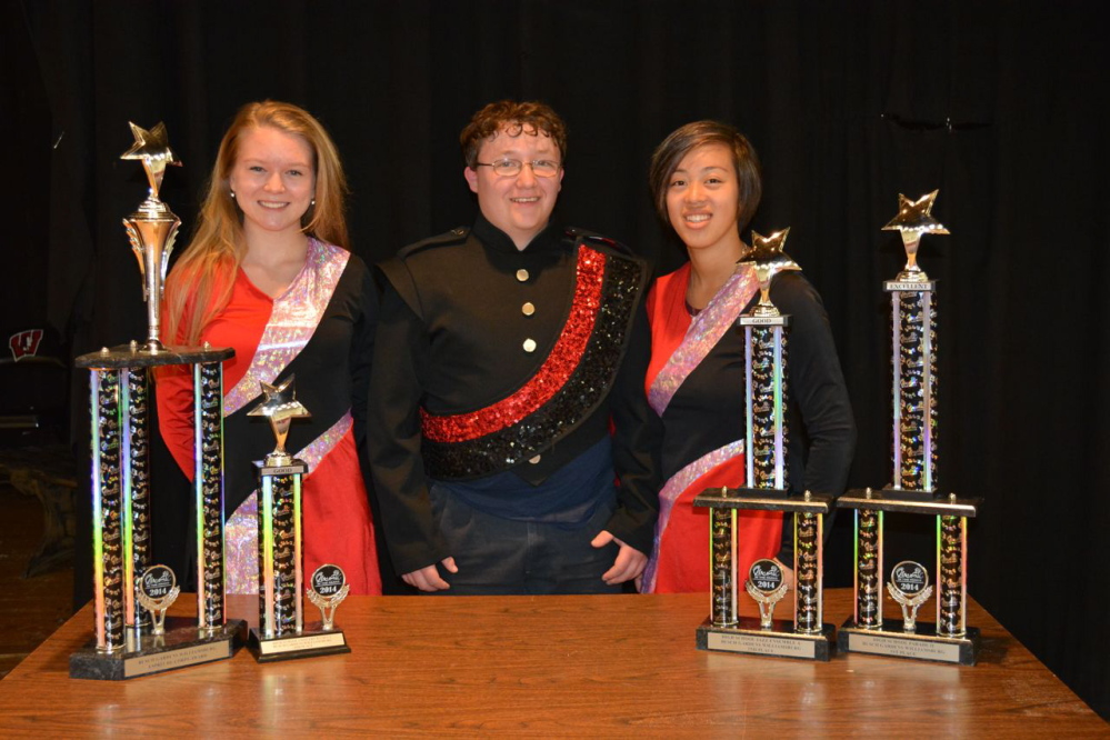 Posing with trophies received at the Music in the Parks band competition at Williamsburg, Va., are, from left, Adrienne Perron (color guard captain), Brandon Cox (drum major) and Emilee Wooldridge (color guard captain). The high school's parade, concert and jazz bands placed first, fourth and second, respectively, and also won the prestigious Esprit de Corps Award for the third time. Photo courtesy Laura Bell
