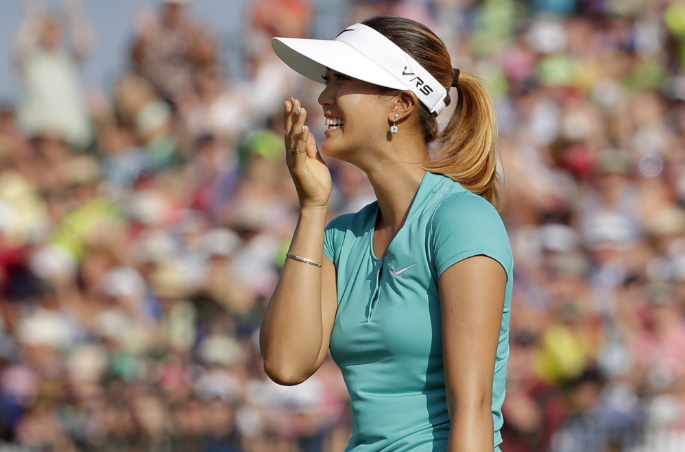 Michelle Wie reacts after winning the U.S. Women's Open on Sunday in Pinehurst, N.C. Wie shot even-par 70 in the final round to beat top-ranked Stacy Lewis by two strokes.