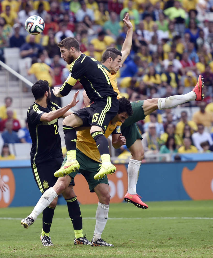 Spain's Sergio Ramos wins a header during the group B World Cup soccer match between Australia and Spain at the Arena da Baixada in Curitiba, Brazil, Monday, June 23, 2014.