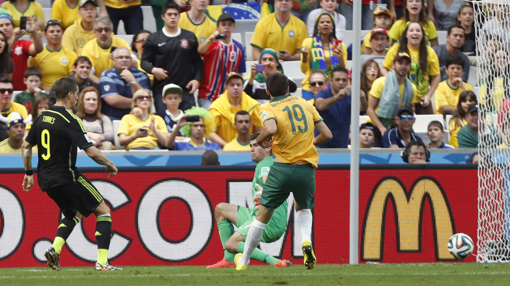 Spain's Fernando Torres, left, scores his side's second goal during the group B World Cup soccer match between Australia and Spain at the Arena da Baixada in Curitiba, Brazil, Monday, June 23, 2014.