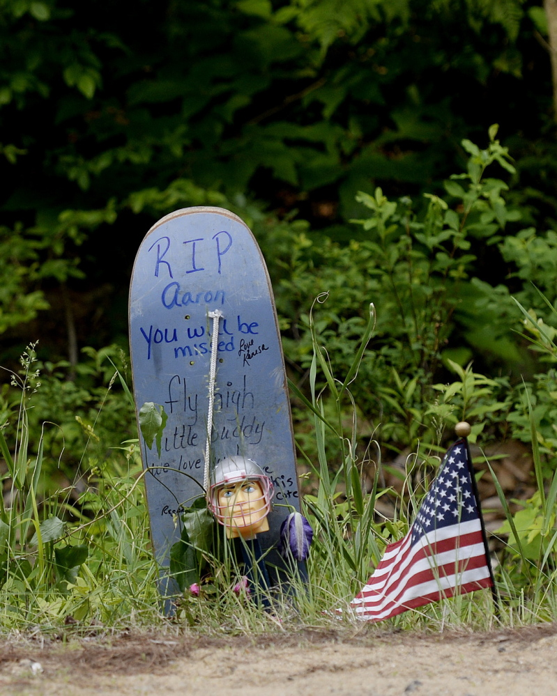 Shawn Patrick Ouellette/Staff Photographer A makeshift memorial stands along Long Swamp Road in Lebanon on Monday. Police have identified a man who was found fatally stabbed in Lebanon on Saturday as 18-year-old Aaron Wilkinson.