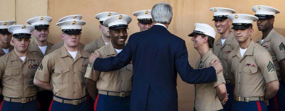 U.S. Secretary of State John Kerry greets U.S. Marines as he arrives at the U.S. Embassy in Baghdad, Iraq, on Monday. Kerry said the fate of Iraq is largely dependent on whether its leaders meet a deadline for starting to form a new government.
