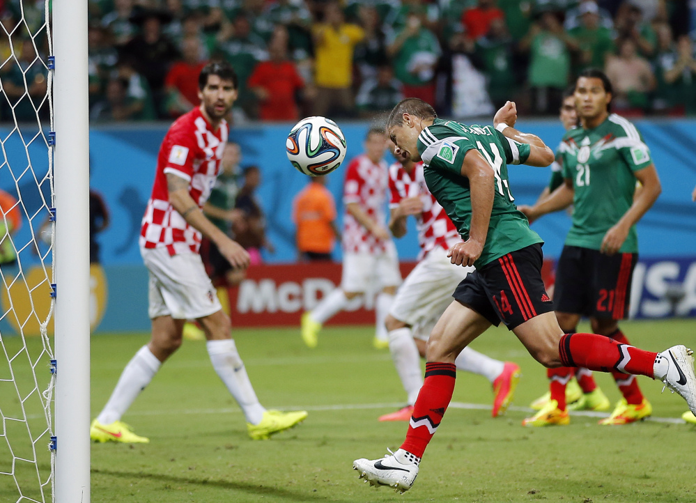 Mexico's Javier Hernandez scores during the group A World Cup soccer match between Croatia and Mexico at the Arena Pernambuco in Recife, Brazil, Monday, June 23, 2014.