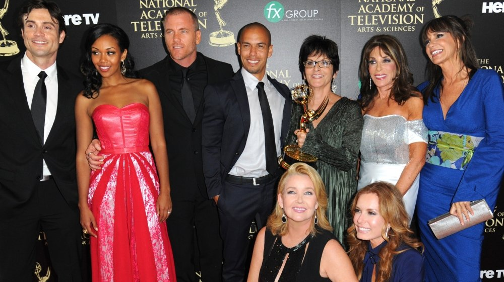 "The cast and crew of ""The Young and the Restless"" pose with the award for outstanding drama series at the 41st Daytime Emmy Awards on Sunday in Beverly Hills, Calif."