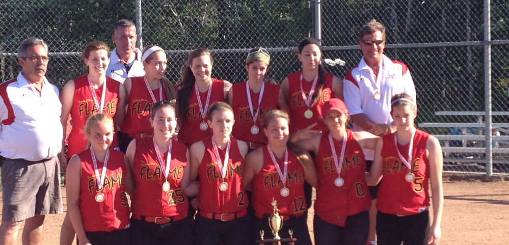 """The Southern Maine Flame ASA women's under-18 softball team won the Southern Maine Diamond Challenge """"A"""" Fastpitch tournament from June 13-15 at Wainwright Sports Complex in South Portland. The Flame defeated the Northeast Hurricanes 9-2 in the championship game. Team members, from left to right: Front – Miranda Eisenhart, Sam Dibiase, Michaela Willwerth, Olivia Indorf, Danica Gleason and Emily Robida; Back – Coach Ralph Aceto, Katie Rabasca, Coach Mike Gleason, Miranda Gleason, Miranda Moore, Carla Tripp, Kristal Smith and Coach Paul Indorf; Missing – Coach Glenn Smith."""