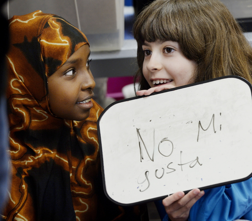 Samira Yusuf, left, and Altana Johnson work together during Spanish class at Lyseth Elementary School in Portland.