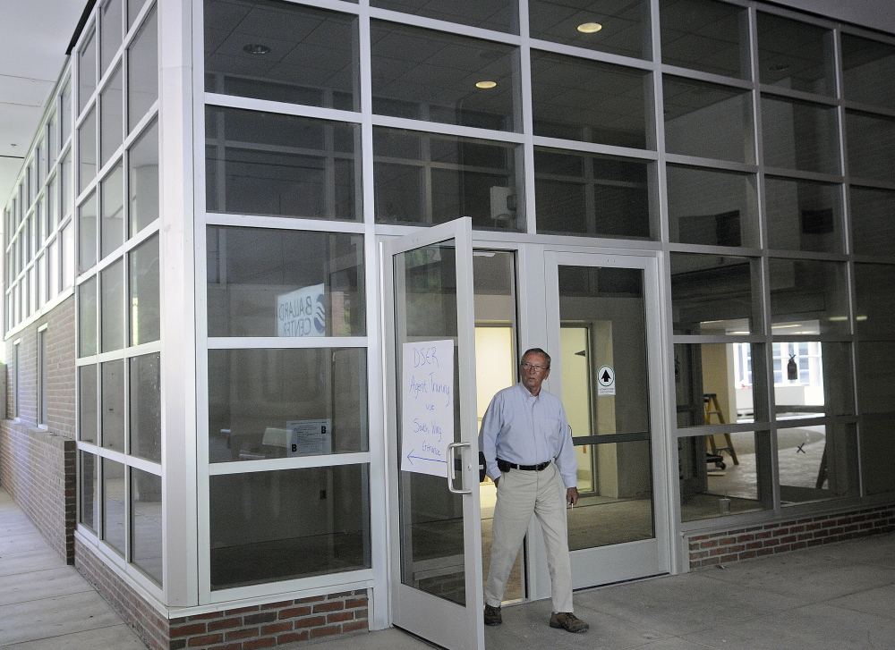 Bill Dowling of Mattson Development exits through the atrium entrance of the former MaineGeneral hospital building in Augusta on Monday.
