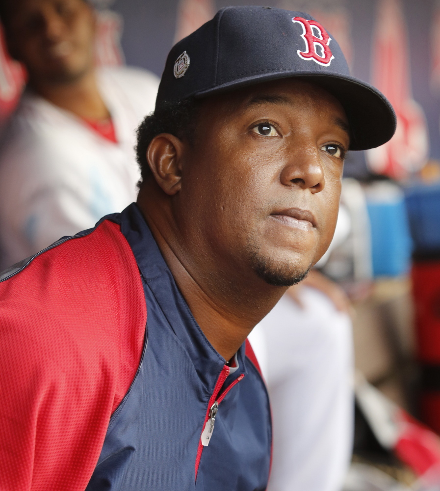 Pedro Martinez, the former Red Sox pitching great who works with the team's minor league pitchers, watched the game from the Portland Sea Dogs' dugout.