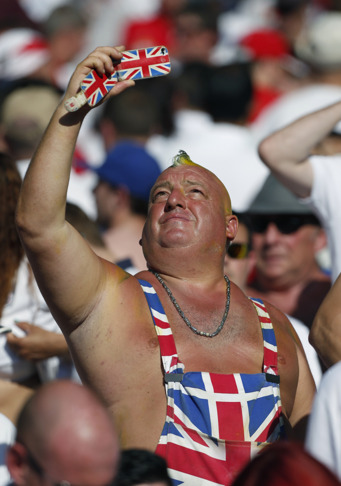 An England supporter takes a photo after the group D World Cup soccer match between Costa Rica and England at the Mineirao Stadium in Belo Horizonte, Brazil, Tuesday, June 24, 2014.
