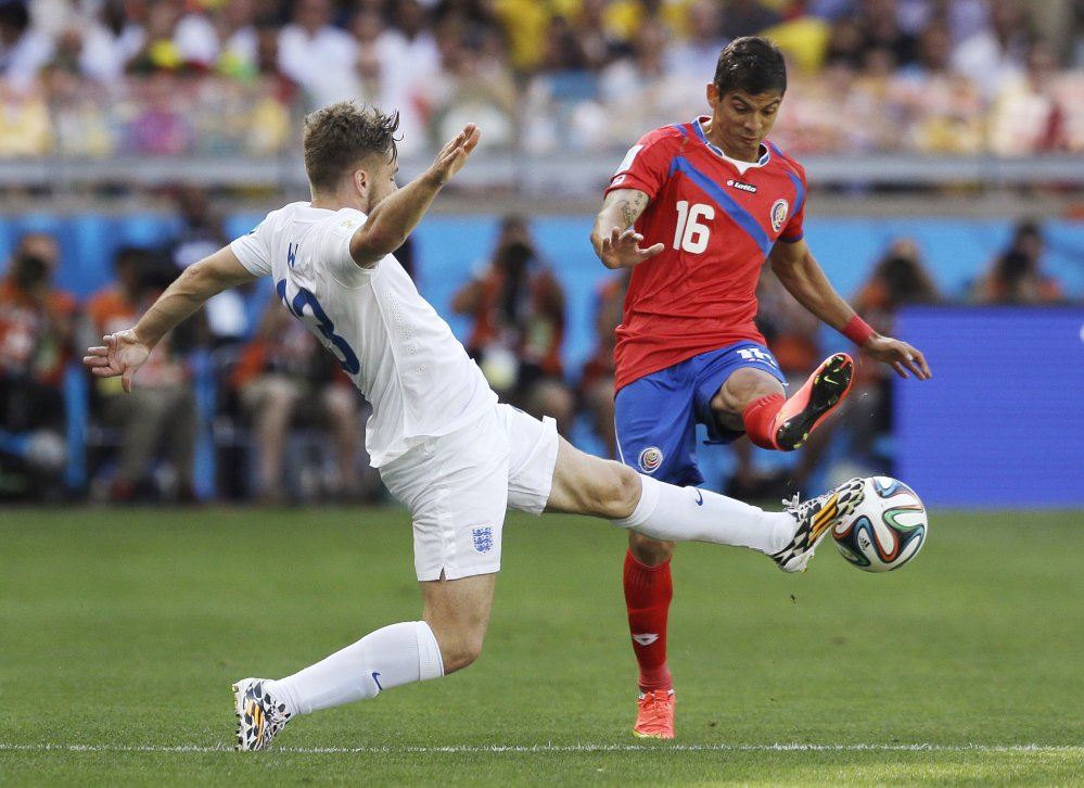 England's Luke Shaw, left, challenges Costa Rica's Cristian Gamboa during the group D World Cup soccer match between Costa Rica and England.