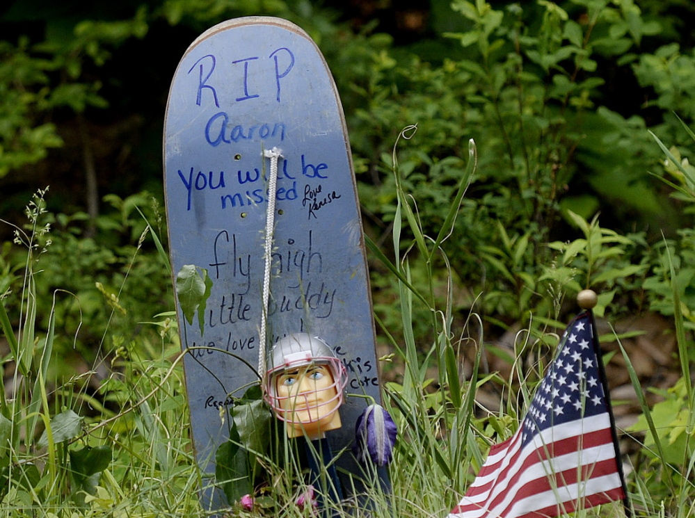A makeshift memorial for Aaron Wilkinson, 18, of Madbury New Hampshire, stands along Long Swamp Road in Lebanon. He was known as a compassionate, friendly, optimistic person.