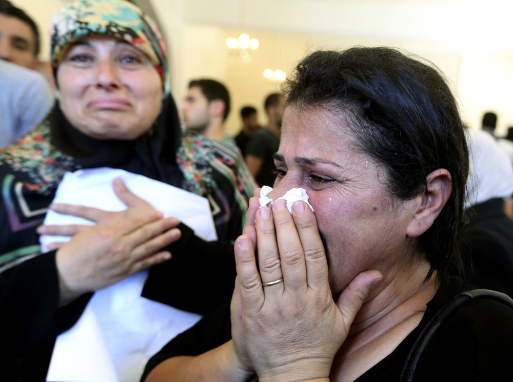 Relatives of Abdul-Karim Hodroj, a security officer who was killed Tuesday by a car bomb, weep during his funeral procession in the southern suburb of Beirut, Lebanon, on Wednesday. Violence continued Wednesday when a suspect blew himself up in his hotel room.