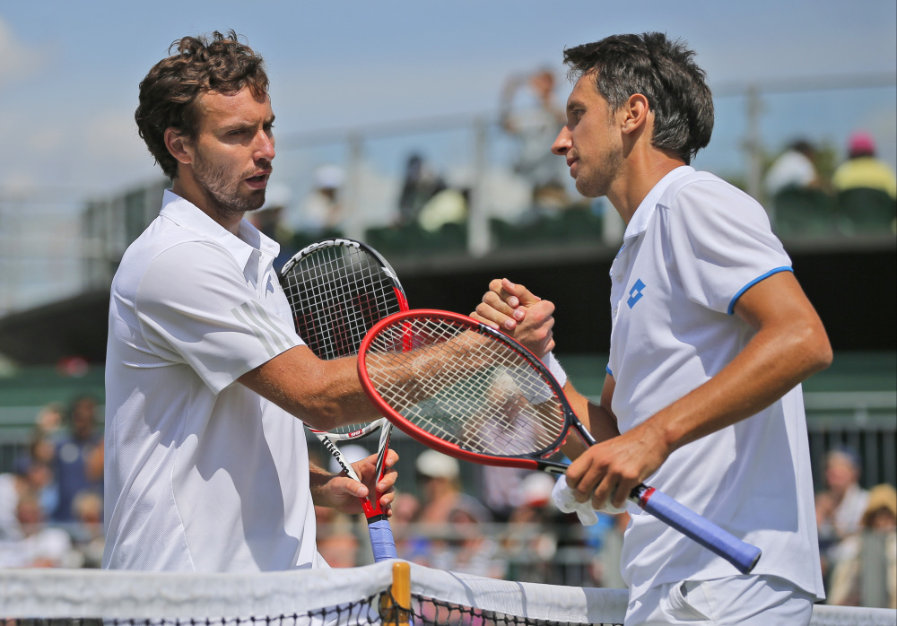 Sergiy Stakhovsky of Ukraine, right, shakes hands with Ernests Gulbis of Latvia following their men's singles match at the All England Lawn Tennis Championships in Wimbledon, London, on Wednesday.