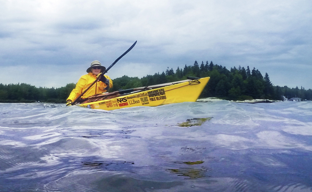 Deb Walters of Troy paddles off Owls Head on Wednesday. She intends to spend a year kayaking 2,500 miles from Maine to Guatemala, while raising money for additional grades in schools set up in Guatemala City by Safe Passage, a Maine-based nonprofit.