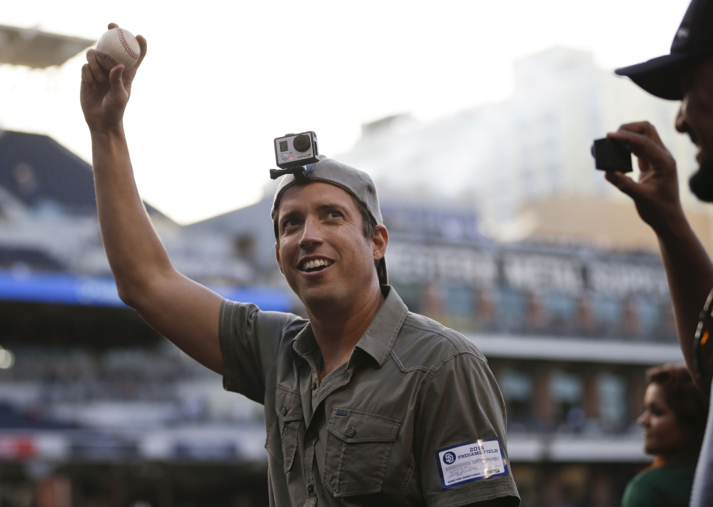 GoPro founder and CEO Nicholas Woodman wears a GoPro camera on his head as he throws the ceremonial first pitch in San Diego. GoPro will begin trading Thursday on the Nasdaq.