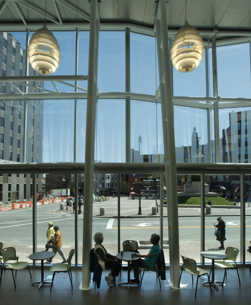 The glass facade of the Portland Public Library, with its sweeping views of Monument Square, was added as part of a $7.3 million renovation. Executive Director Stephen Podgajny's passion about the importance of libraries helped build support for the project.