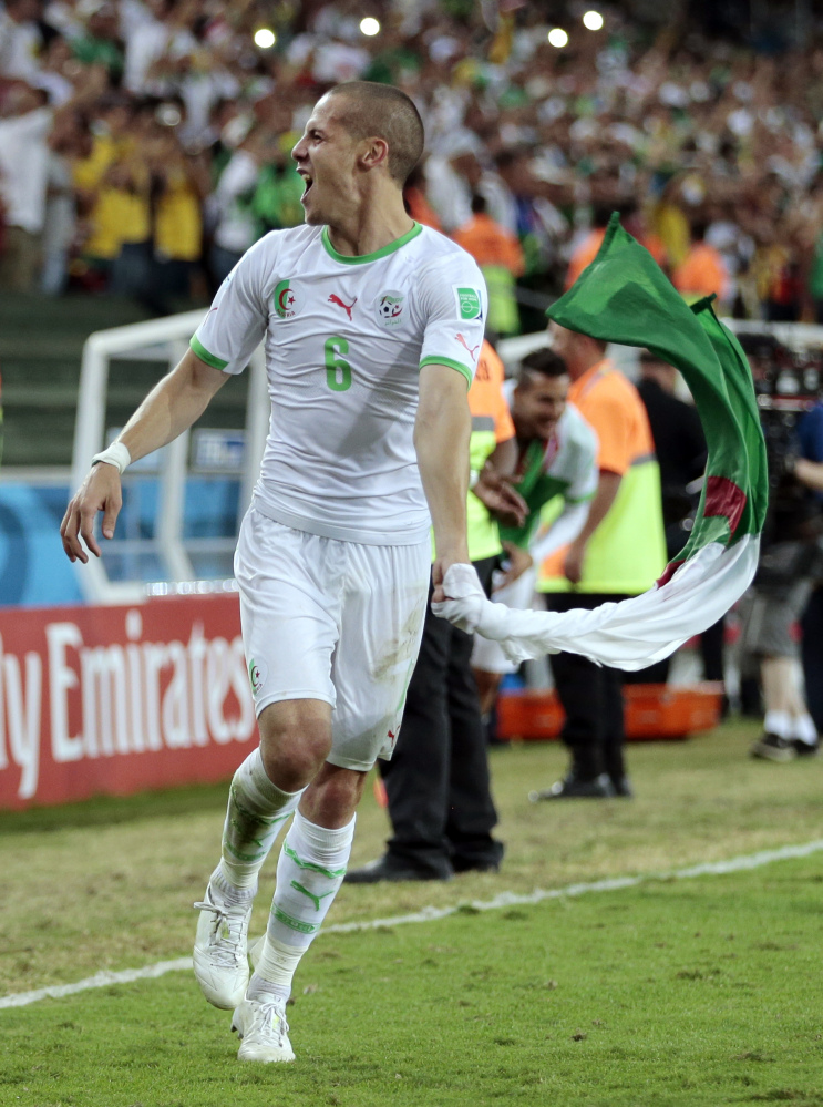 Algeria's Djamel Mesbah celebrates after the group H World Cup soccer match between Algeria and Russia at the Arena da Baixada in Curitiba, Brazil, on Thursday.