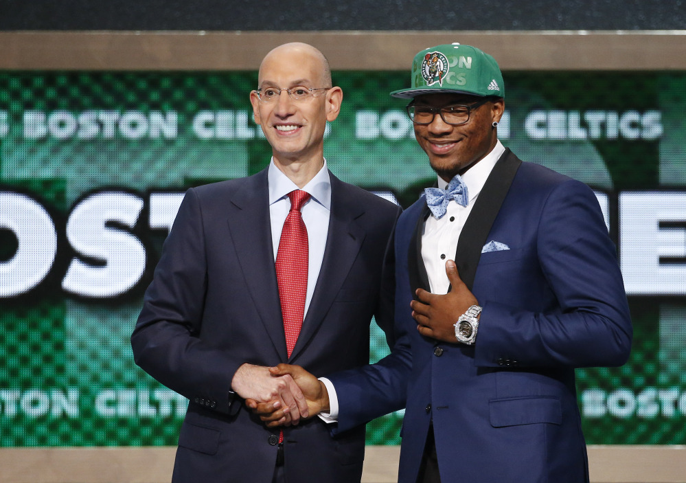 Oklahoma State's Marcus Smart, right, poses for a photo with NBA commissioner Adam Silver after being selected sixth overall by the Boston Celtics during the 2014 NBA draft Thursday in New York.