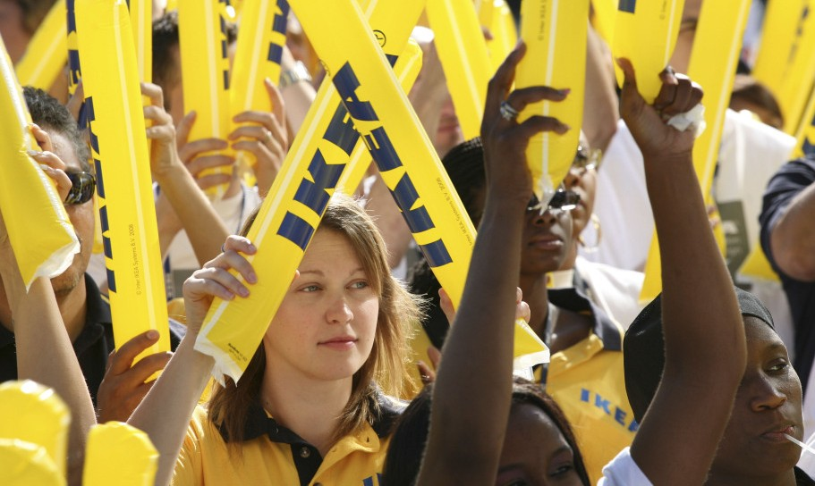 Ikea employees cheer during the grand opening of New York City's first Ikea store, in Brooklyn, on June 18, 2008.