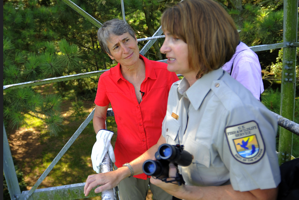 U.S. Interior Secretary Sally Jewell, left, listens to U.S. Fish and Wildlife Service refuge manager Kimberly Hayes during a tour of the Harris Neck National Wildlife Refuge.