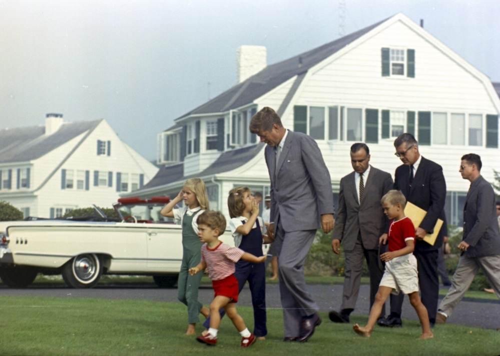 President Kennedy approaches a helicopter in Hyannis Port, Mass., on Aug. 26, 1963. With him are, from left: Sydney Lawford, John F. Kennedy Jr., Caroline Kennedy, Secret Service agent Sam Sulliman, David Kennedy, and agents Jerry Behn and Tom Wells.