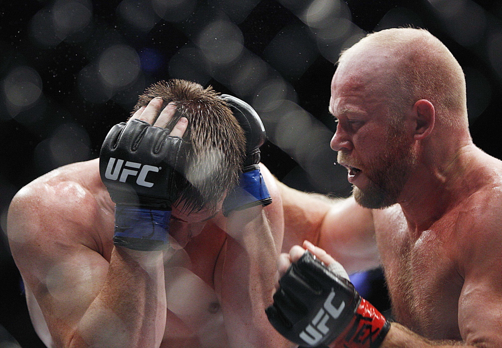 Tim Boetsch, right, had C.B. Dollaway shielding himself from punches during this fight in October. Boetsch, a four-time Maine high school wrestling champ from Lincolnville, is back in Maine for a match Saturday night in Bangor.