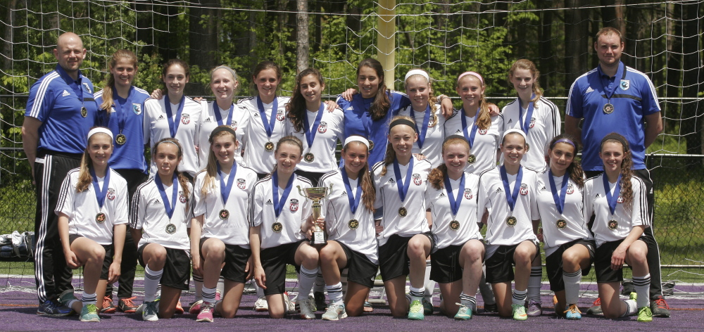 Members of the MCU Portland Phoenix U14 girls' soccer team, from left to right, front row: Elizabeth Flynn, Sarah Thill, Ewa Varney, Sara D'Appolonia, Hallie Schwartzman, Amelia Waite, Sara Barrett, Hannah Cottis, Ellie Patten and Maggie Lloyd. Back row: assistant coach Seb D'Appolonia, Grace Roberts, Hannah Kaplan, Michaela Jordan, Emma Woods, Gaby Panagakos, Meghana Clere, Caroline Swaney, Cali Wiberg, Grace Lagrange and Coach Craig Fannan. Submitted photo