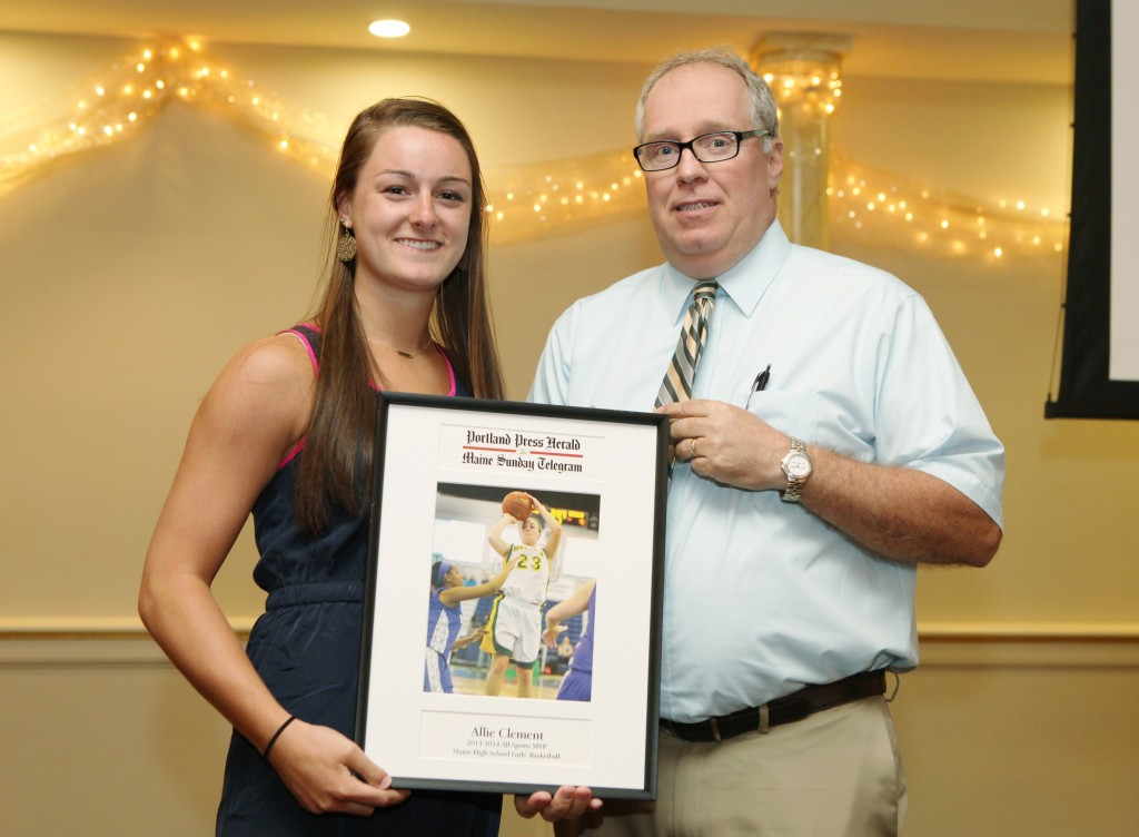 Allie Clement of McAuley High School receives an award for basketball from Press Herald sports writer Mike Lowe during the 27th Annual All-Sports Awards Sunday. Joel Page/Staff Photographer