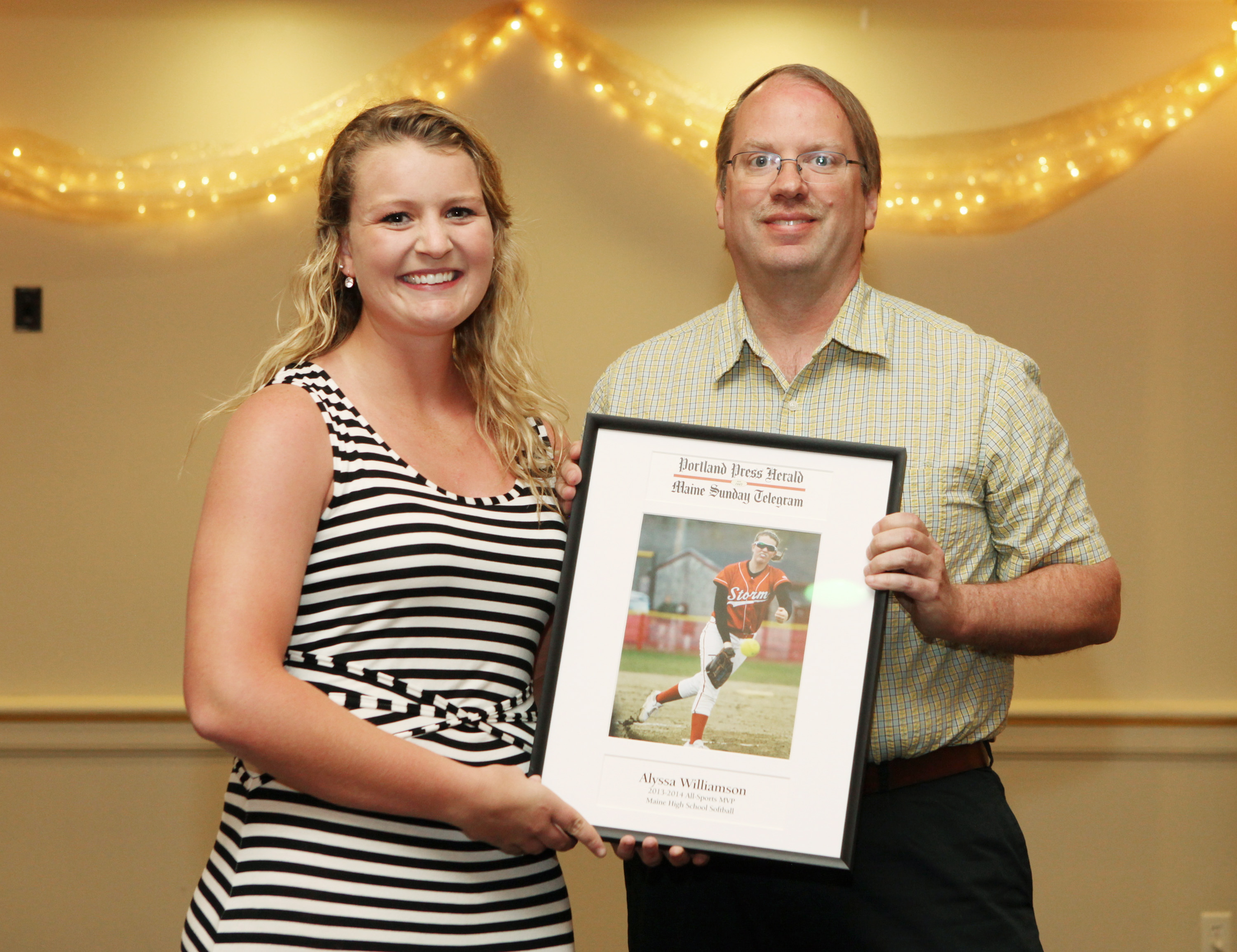 Alyssa Williamson of Scarborough High School receives an award for softball from Press Herald sports writer Mark Emmert during the 27th Annual All-Sports Awards Sunday. Joel Page/Staff Photographer
